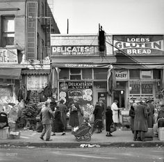 "December 1936. ""Scene along Bathgate Avenue in the Bronx, a section from which many of the New Jersey homesteaders have come."" Medium format negative by Arthur Rothstein for the Resettlement Administration."