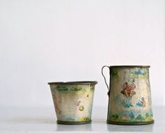 Antique Victorian tin litho playtime cup and pitcher.