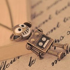 fashion cute retro bronze with music earphone headset robot pendent necklace #UnbrandedGeneric