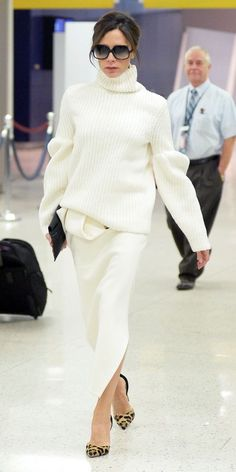 Victoria Beckham was snapped catching a flight out of JFK in a sleek jet-setting outfit—of her own design, of course. She wore an ivory chunky oversize turtleneck knit and a slim midi-length skirt, complete with her trademark shades, a black clutch in her grip, and fierce leopard-print pumps.
