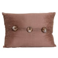 Style your couch or sofa with the Tan Porter Button Oblong Pillow! Finished in a neutral tan with three natural buttons, this accent complements most décor colors!  Pillow measures 22L x 16H in. Made of 50% nylon and 50% polyester Tan finish Ribbed nylon texture Accented with three (3) natural buttons Hidden zipper along the back