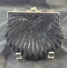 Check out this item in my Etsy shop https://www.etsy.com/listing/252111456/black-seed-bugle-bead-evening-bag-clutch