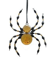 Bring home the Makers Halloween Beaded Spider Ornament-Yellow and add a mystical touch to your fall festive decor. This beaded spider ornament features a sparkling body with beaded legs and head. Crea