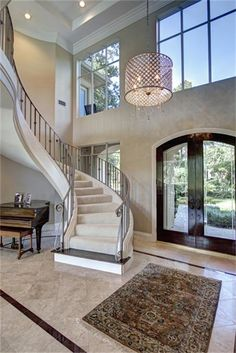 86 Windsail Pl The Woodlands, TX 77381: Photo Two story grand entry with sweeping staircase, wrought iron railings and double glass front doors
