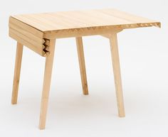 "This ""wooden tablecloth"" folds out to form table extensions."