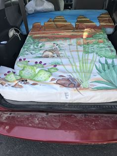 Mattress in my RAV4 with the rear seats down.  Decent fit.  Plenty of room for me to sit up.