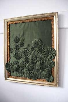 Gorgeous use of Suffolk puffs in deep forest green silk. I love it.