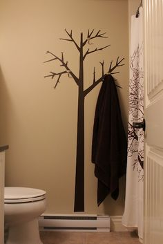 "I like this idea, may use it as a coat ""rack"" in the living room- vinyl tree with hooks"