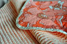 """•1 1/4 yds printed cotton fabric (high-quality quilting weight or home decor weight with a soft finish)  •1 1/4 yds each of three coordinating cotton flannels  • At least two full spools of thread  • 180"""" of seam binding  • Olfa's Chenille Cutter tool"""