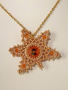 A tutorial showing you how to make a pretty Maple Leaf Pendant using a rivoli, crystal bicones and seed beads. The 22 page tutorial includes:* Introduction* Tips & information* Materials list* Step-by-step photos and instructions Please note:* This is a PD...