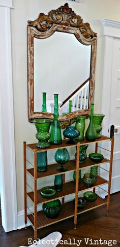 Amazing vintage green glass collection in this beautiful entryway - eclecticallyvintage.com