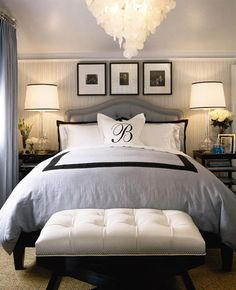 LOVE IT!! Frames over bed, glass lamps, monogrammed pillow, padded bench, and chandelier! I love the gray | black | white color scheme. {Home Decorating Ideas}
