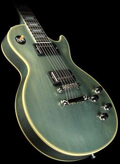 57 Gibson Les Paul Antiqued Pelham Blue turns green as it ages.