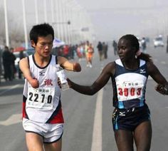 Heroes in everyday life - A Kenyan elite runner passes water to a dehydrated disabled Chinese runner who was suffering. This slowed her time--she came in 2nd in the race--not only costing her the win but also the $10,000 cash prize. It's not all about winning.