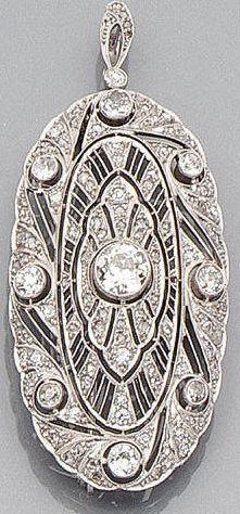 An art deco diamond pendant/brooch, circa 1930 #DiamondBrooches #diamondpendant #DiamondJewellery