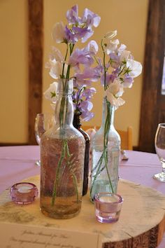 Vintage bottles on tree rounds.  Great for wedding or just a dining table! @ The Woodlands at Cottonwood Canyon