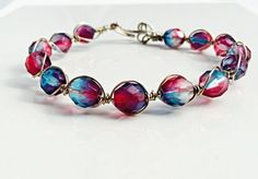 Beautiful red and blue bracelet using a wire wrapping technique. * Red blue Czech beads * Silver wire Measure:7 inch