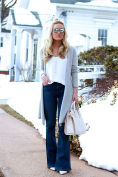 Flare denim with gray cardigan, pumps, and the perfect Saint Laurent Sac de Jour handbag dupe.