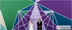 Newly weds in front of a colorful backdrop. #weddings #bride #groom #brideandgroom #nepweddings #purple #blue #green #weddingphotography