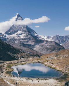 When the Riffelsee Lake waters are calm, they gift you the most beautiful reflection of the iconic Matterhorn. Zermatt, Landscape Photos, Beautiful Day, Switzerland, Mount Everest, Mountains, Water, Places, Travel