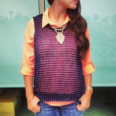 vest. buttondown. statement necklace.