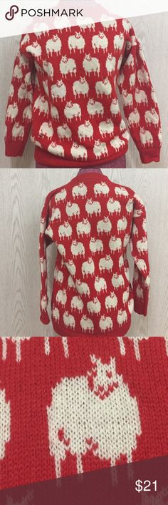"""Vintage 80s Wool Sweater with Sheep  Made in Great Britain  Has 5 holes which can possibly be fixed. Largest holes are pictured. One hole looks like a cigarette burn. The sweater has been washed and does not smell like smoke. There is no size tag but mannequin is a size small and sweater fits mannequin well. Measurements pit to pit 19"""" length 26"""" including band Vintage Sweaters Crew & Scoop Necks"""