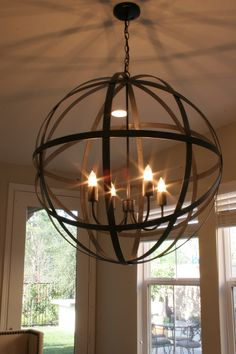 RESTORATION HARDWARE chandelier - Get the junk store guy to make a bunch of these. Hanging between pillars filled with flowers and olive branches