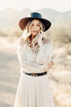 570b80f2594 Caitlin Lindquist of the Arizona fashion blog Dash of Darling wears a Spell  Designs white lace