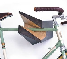 Iceberg Wooden Bike Hanger / Hang your bike on the wall and turn it into a work of art with the Iceberg Wooden Bike Hanger by Woodstick. http://thegadgetflow.com/portfolio/iceberg-wooden-bike-hanger-720/