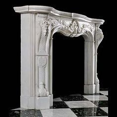 An Antique Rococo Marble Fireplace Mantel