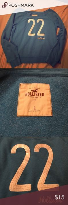 Hollister Sweater Hollister Sweater size Large. Blue and white with sequins in good condition! Hollister Sweaters Crew & Scoop Necks