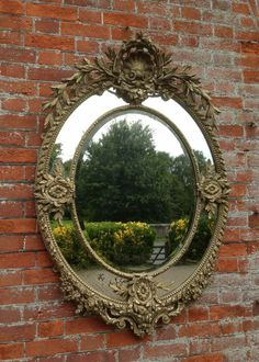 Antique Ornate / crested mirrors  - A wonderful large antique 19th Century French carved wood & gesso cream and gilt oval mirror surrounded by highly decorative leaf & shell original mouldings with fabulous original bevelled mirror and backboards.  Mesurements:  1 metre 38 cm high  94cm wide