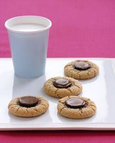 Peanut Butter Surprise Cookies - Press mini peanut butter cups into peanut butter cookie dough to make these crowd-pleasing cookies. If you like, you can use other candies for the topping as well, such as chocolate-covered caramels or halved mini candy bars.