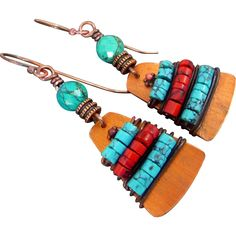 Copper Turquoise And Red Howlite Bohemian Earrings These earrings are HOT off the press! And I am in love with them! What a great combination of colors, materials and textures. Red, copper and turquoise make a wonderful a versatile color scheme. You'll find yourself wearing these all the time. Solid copper sheet was cut, polished, textured, polished again and wrapped with turquoise and coral howlite heishi beads. The earrings measure 2 1/4 inches with nickel free copper ear wires.