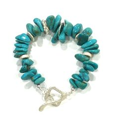Turquoise is the stone of friendship and one of the oldest protection amulets, used in many cultures Turquoise nugget bracelet with brushed sterling silver embellishments and T-Bar clasp Note: In stock, delivery 2-7 business...