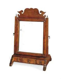A LATE GEORGE III CHERRY SWING-FRAME TOILET MIRROR  EARLY 19TH CENTURY  With fret-carved crest and three drawers  21 in. (54 cm.) high; 13¾ in. (35 cm.) wide; 10¼ in. (26 cm.) deep