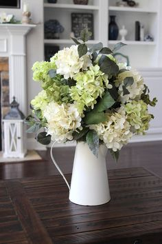 Who doesnt love an arrangement filled with hydrangeas that looks like you just picked them from the garden? This piece is full and looks great from all sides. It contains creamy white and green hydrangeas, green cascading hydrangeas and different greenery. Its finished off in a white