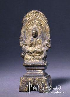 铜鎏金释迦佛造像,北魏太和十七年(493年),高11.8cm,北京故宮博物院藏。