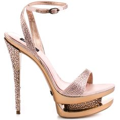 You'll be mistaken for a celebrity every time you slip on this a-list style from ZiGiny Black Label.  Sparkler is covered in a luxurious pink satin embellished with sparkly pink crystals.  A 1 1/2 inch triple stacked platform has a gold mirror effect mixed with a crystal layer.  Last but not least is an eye catching jeweled 5 1/2 inch heel that will make you a star.