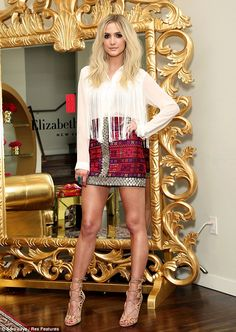 Ashlee Simpson leg show as she wore a high-waisted pink skirt and a sheer white shirt promoting the Elizabeth Arden Beautiful Color Lip Lounge