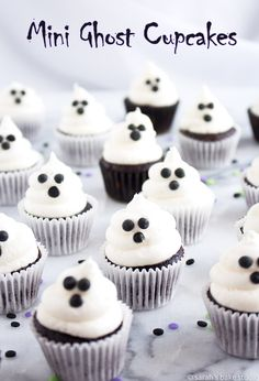 Mini Ghost Cupcakes – bite-sized mini cupcakes topped with ghoulish vanilla buttercream ghosts. Bite-sized mini cupcakes topped with ghoulish vanilla buttercream ghosts. Mini Cupcakes, Ghost Cupcakes, Cupcake Cakes, Kid Cakes, Party Cupcakes, Coconut Cupcakes, Cheesecake Cupcakes, Halloween Desserts, Halloween Treats