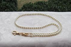 A personal favorite from my Etsy shop https://www.etsy.com/listing/236409016/ivory-pearl-id-badge-lanyard-swarovski