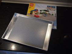 DIY Holiday Gift for Kids - Lego Tray awesome idea! changes instead i would paint the tray the color the kid likes to help determine who's try it is. come up with some kind of carrying case/bag to go with it. would be amazing for a camping trip or long car rides!