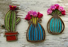 Flowerpot brooches by Odile Gova on Flickr. Felt and deconstructed zippers.