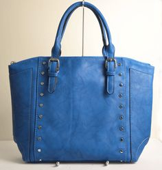 This handbag by Dissona has a top zipper with inside compartments for all essentials, an outside zipper compartment at the back, and a removable shoulder strap. Cole Haan, Stuart Weitzman, Shoulder Strap, Essentials, Zipper, Tote Bag, Top, Blue, Collection