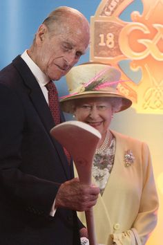 Queen Elizabeth II and Prince Philip, Duke of Edinburgh are presented with a hurley during a visit to Croke Park on May 18, 2011 in Dublin, Ireland. The Duke and Queen's visit to Ireland is the first by a monarch since 1911. An unprecedented security operation is taking place with much of the centre of Dublin turning into a car free zone. Republican dissident groups have made it clear they are intent on disrupting proceedings.