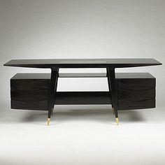 Lot 118: Gio Ponti. executive desk. 1950, walnut, brass, glass. 78½ w x 27½ d x 31½ h in. result: $106,200. estimate: $35,000–45,000. A large and finely detailed desk of symmetrical form with transparent writing surface and two drawered cabinets. Sold with a signed letter of authenticity by Lisa Licitra Ponti. Provenance: Private collection, Milan