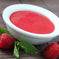 This classic dessert sauce can be served with chocolate souffles and cheesecakes, over ice cream, alongside bread puddings—or even stirred into plain yogurt. Raspberry Sauce, Raspberry Filling, Dessert Sauces, Dessert Recipes, Delicious Desserts, Vegan Desserts, Sauce For Eggs, Chef John Recipes, Chocolate Souffle