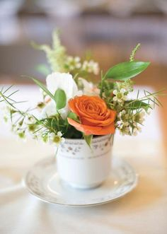 Loving this petite floral arrangement in a cute little vintage tea cup! Photo by Ely Fair Photography.