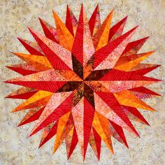Starburst Unfinished QuiltTop 30  in Orange and Red Batiks by Patchmaker